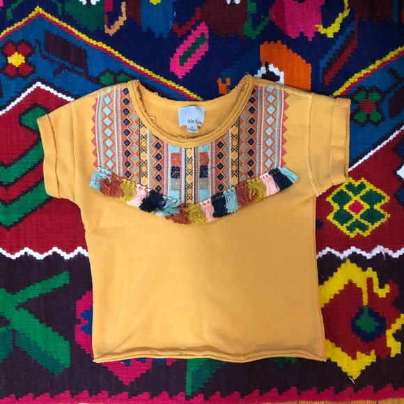 Anthopologie Yellow tee with tassels